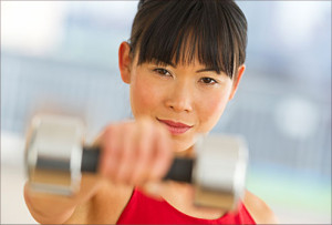 getty_rf_photo_of_a_woman_using_a_dumbbell